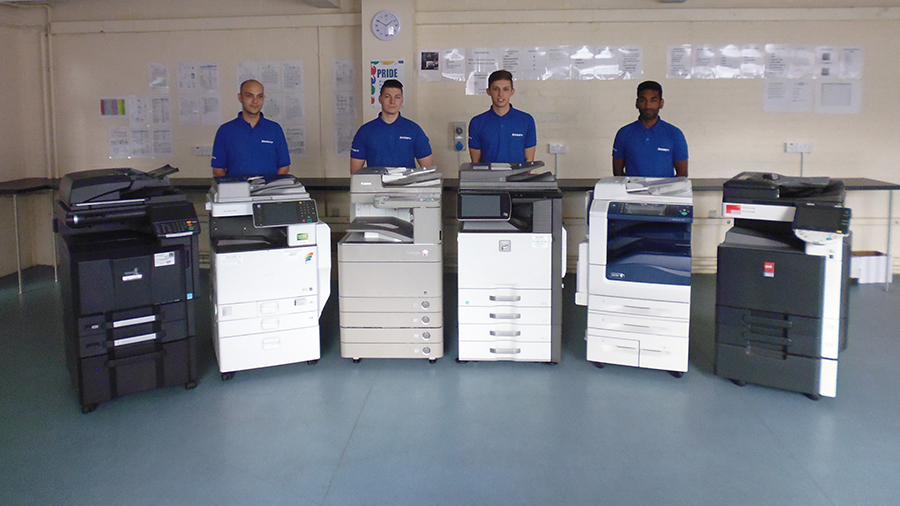 Tecserv team with photocopiers